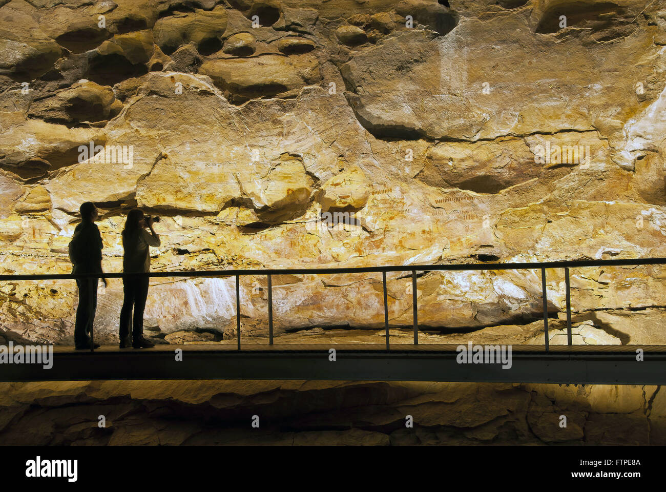 Catwalk for night time visits to the cave paintings in Boqueirao Holed Stone - Stock Image