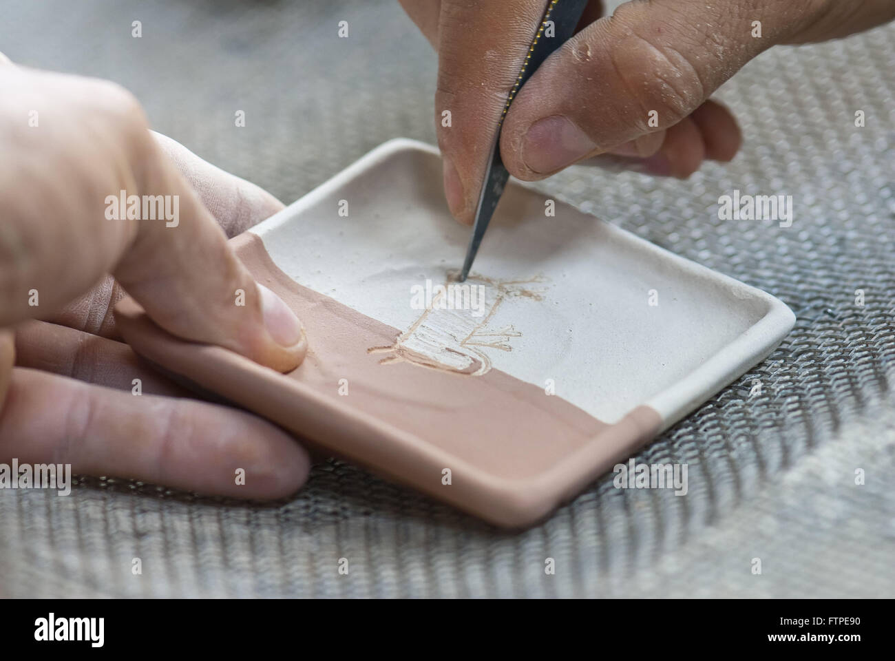 Artisan piece drawing on Ceramica Serra da Capybara - Stock Image
