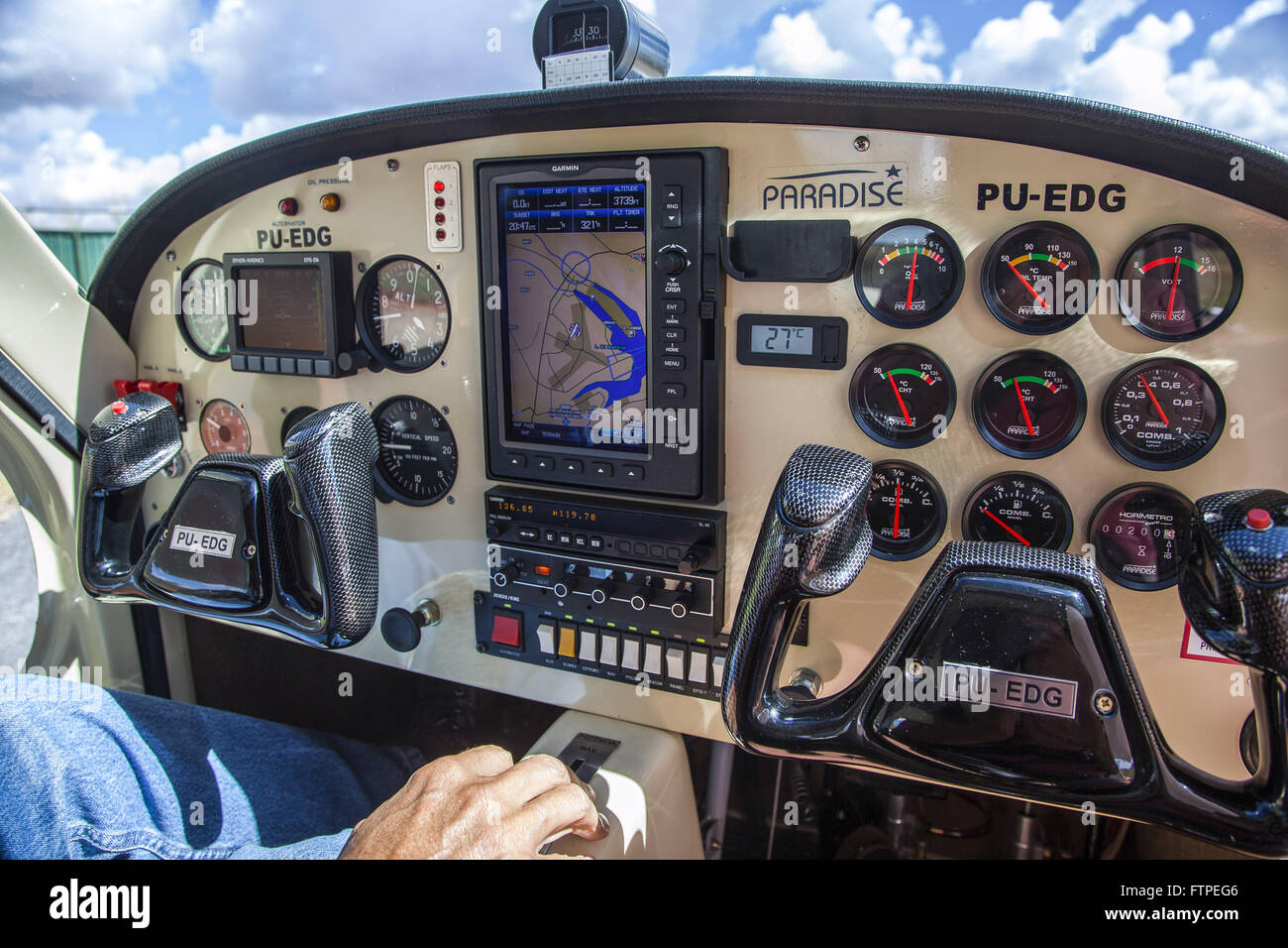 Pilot checking panel before takeoff - Stock Image