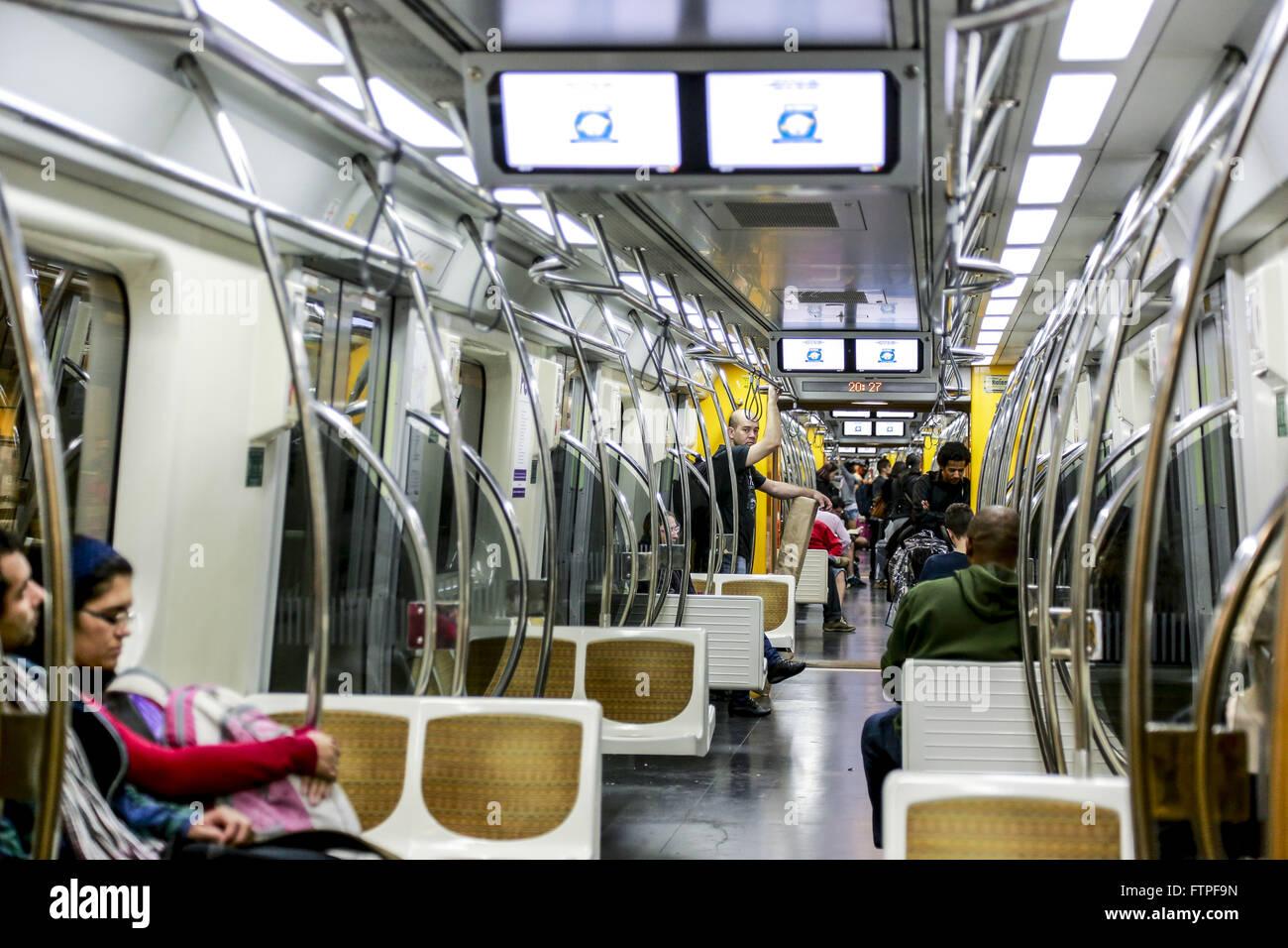 Passengers inside the subway car Yellow Line - Stock Image