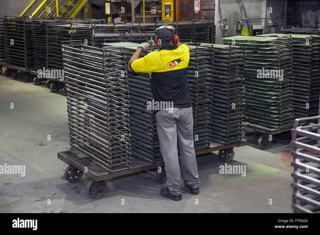 Laborer in manufacturing of electrodes used for welding - Stock Image