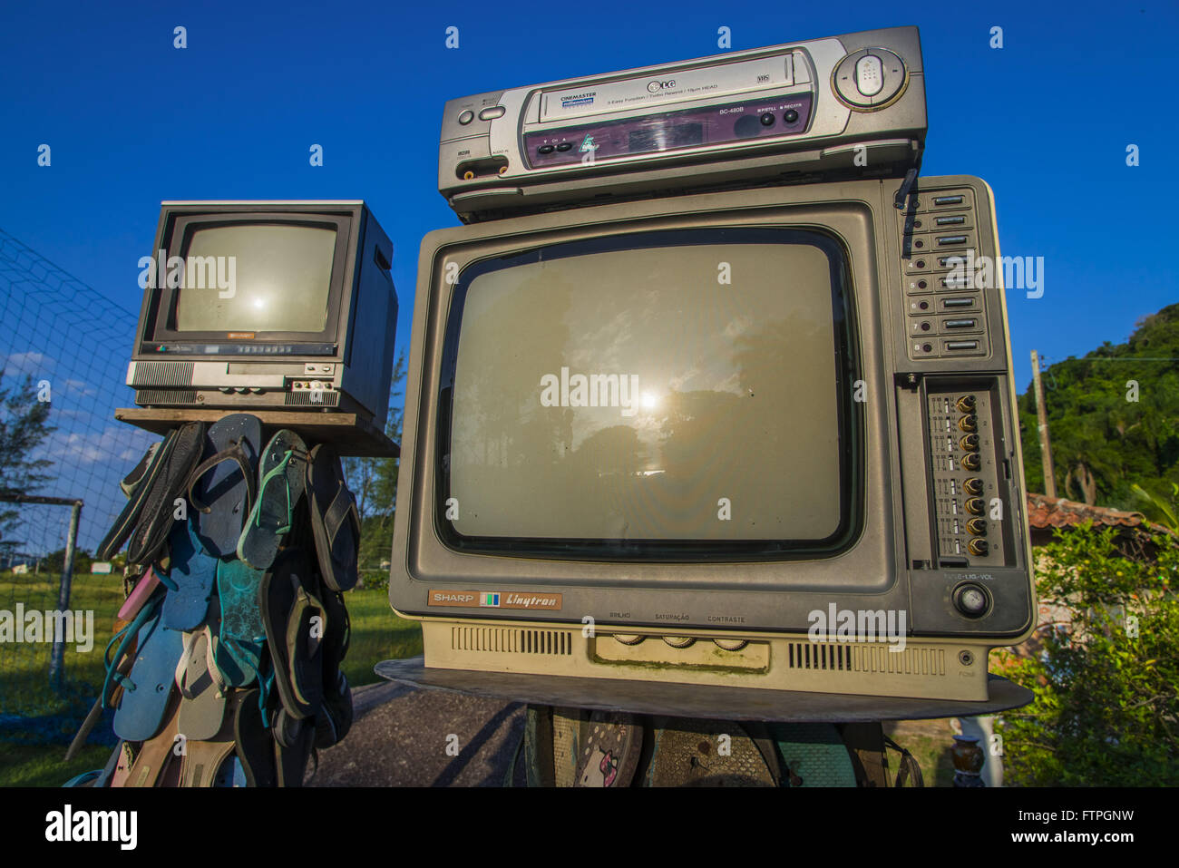 Detail of art installation with slippers and televisions in Inlet Beach - Stock Image