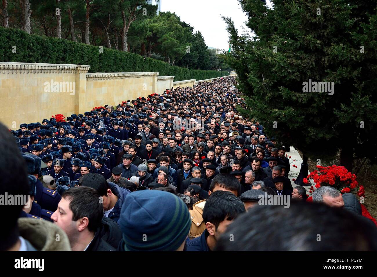 BAKU, AZERBAIJAN - JANUARY 20 2014 Crowds of cadets and mourners at monument in Baku, on anniversary of killings - Stock Image