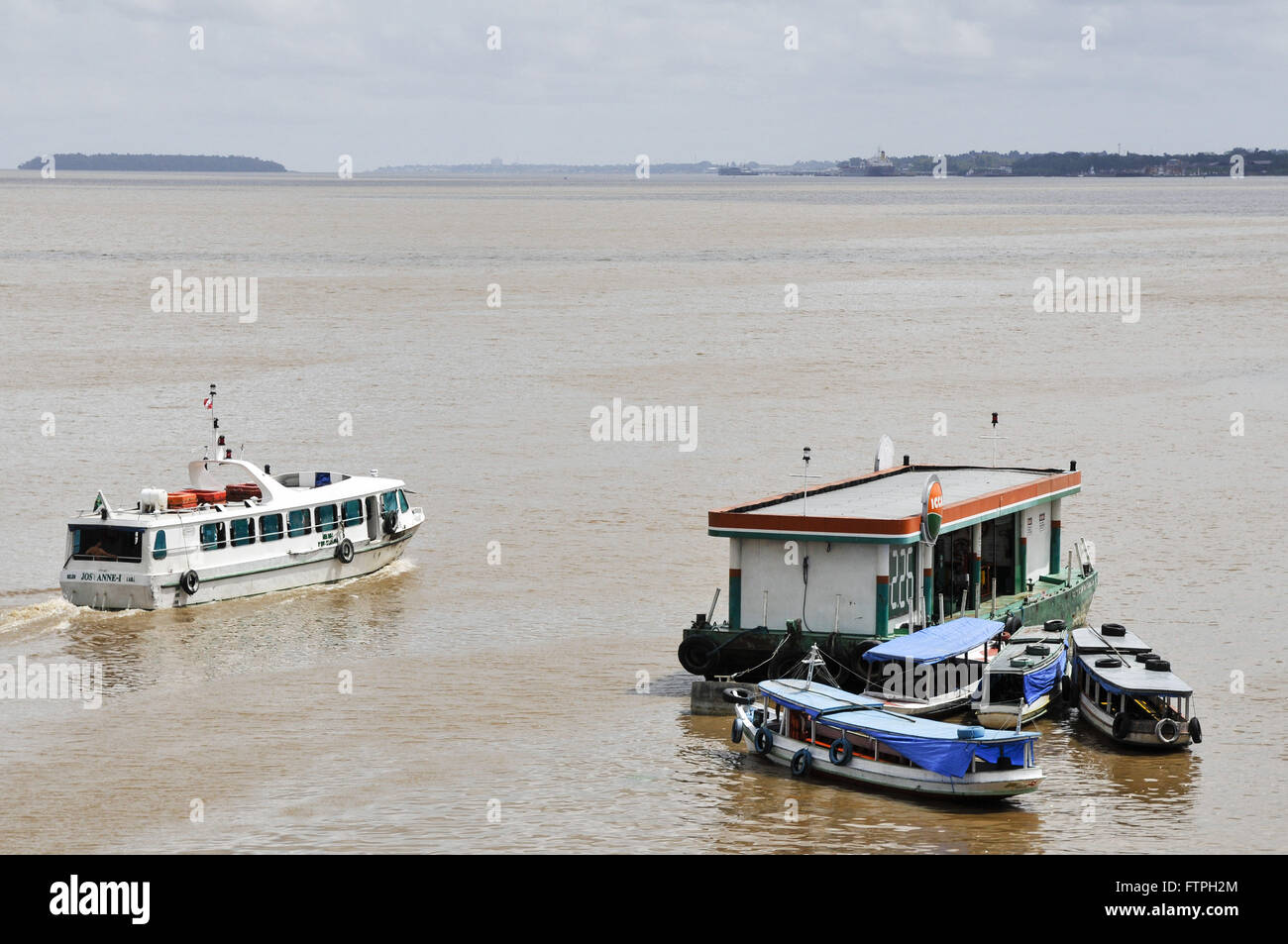 Anchored near the ride to Fort Crib boats in Old Town - Stock Image