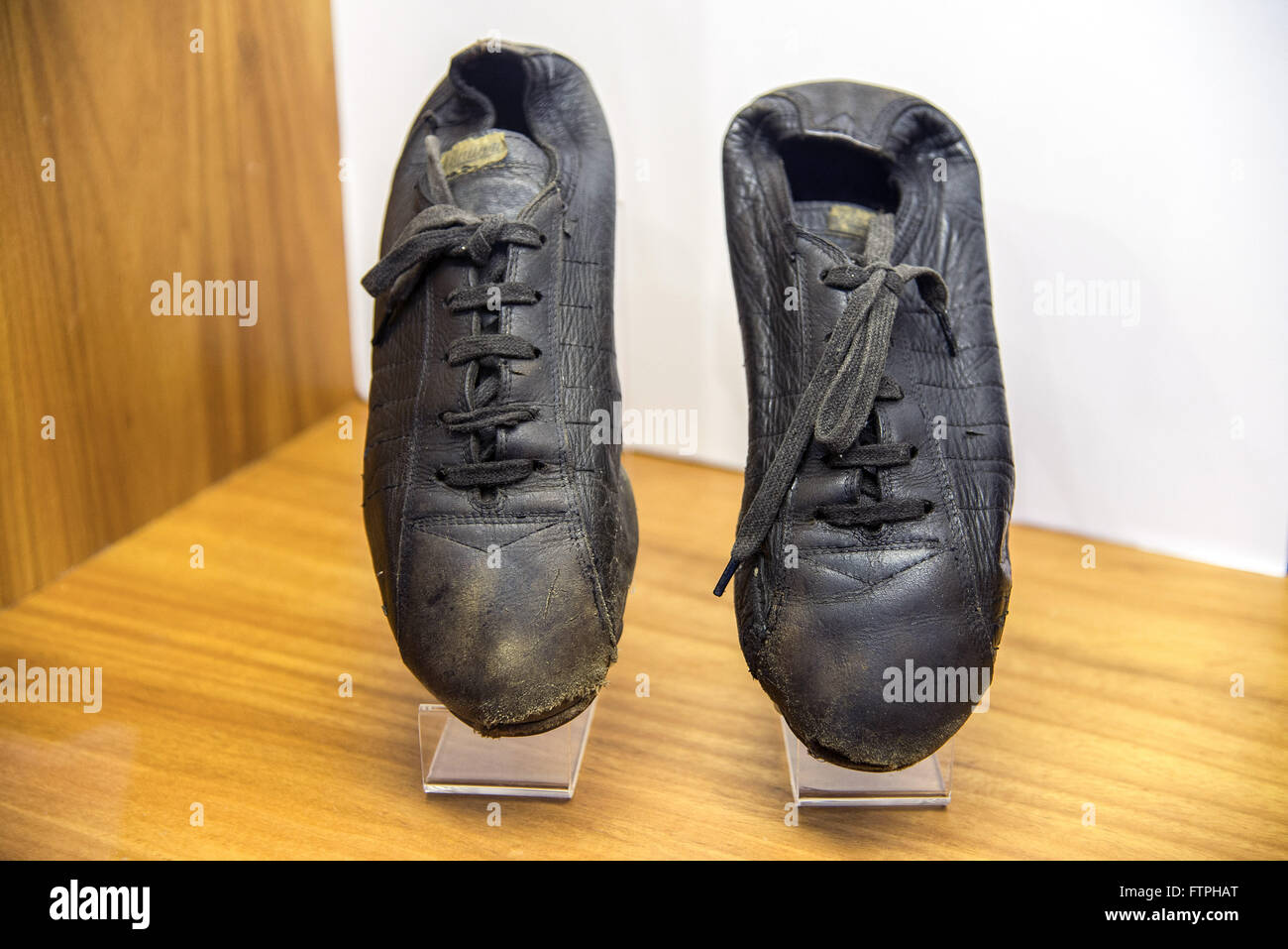 Cleats used by Pele football player in the beginning of his career - Skin Museum - Stock Image