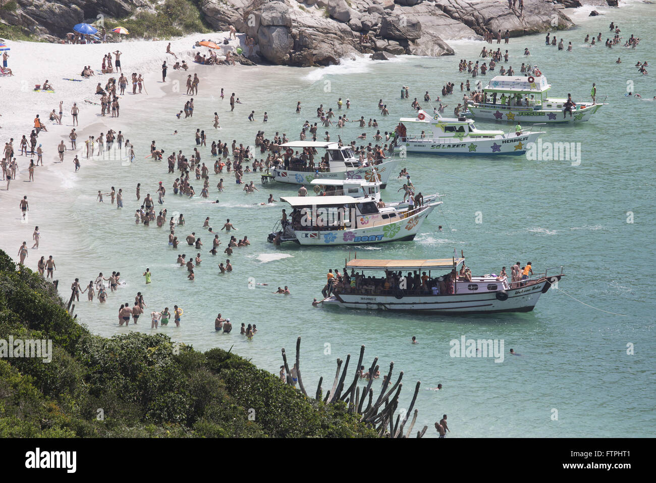 Swimmers and boats in the Prainha of Depth Watchtower - Stock Image