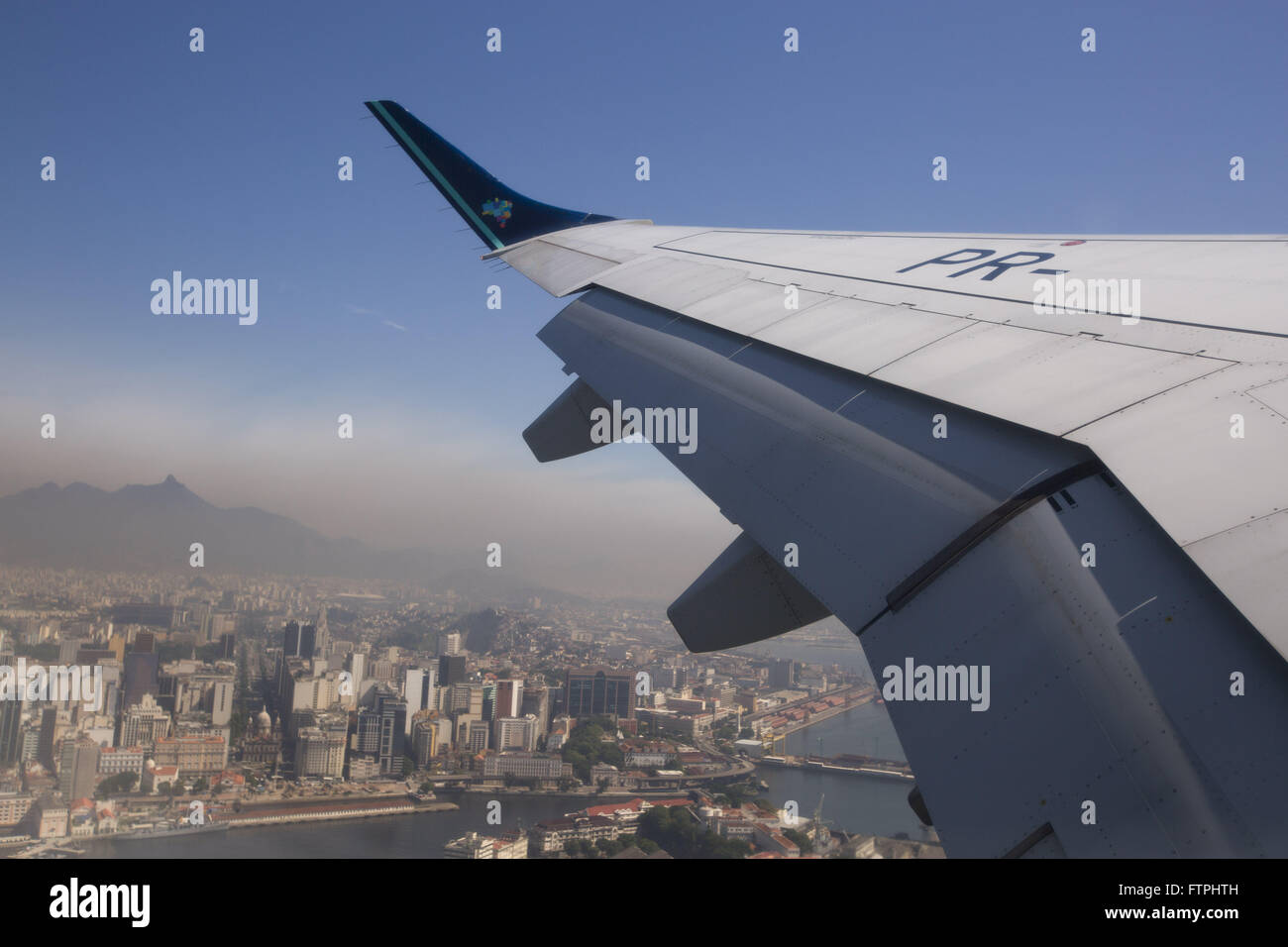 Aircraft wing detail during takeoff at Santos Dumont Airport - Stock Image