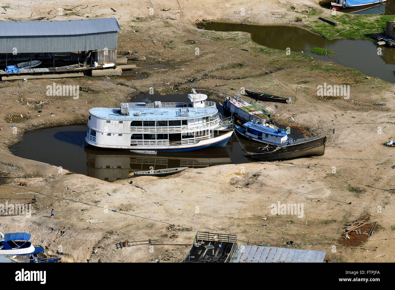Drought in the Rio Negro - Beached Boats in the marina David - Stock Image