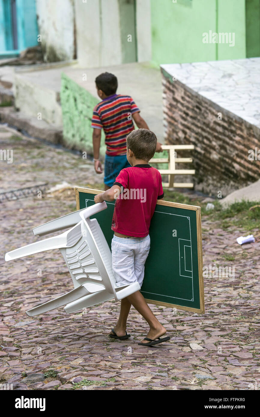 Boy carrying table football table in the Colina do Horto - Stock Image