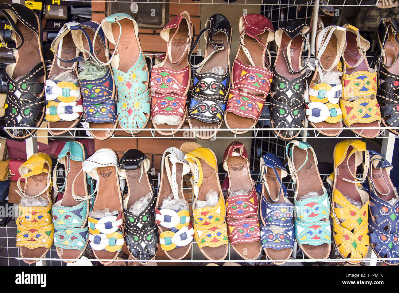 Leather sandals for sale at the fair in Caruaru - Stock Image