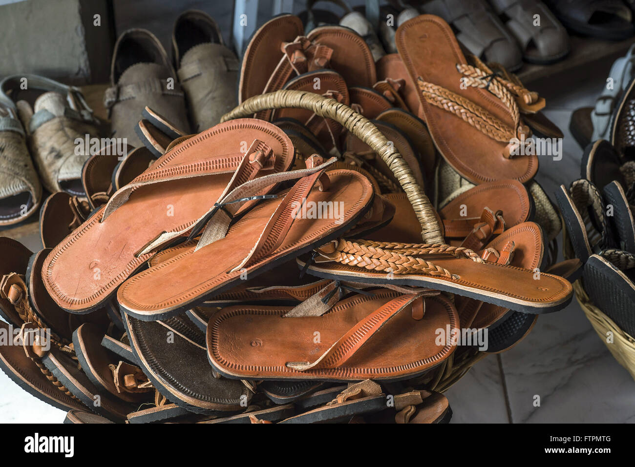 Leather sandals and slippers for sale in Feira de Caruaru - Stock Image