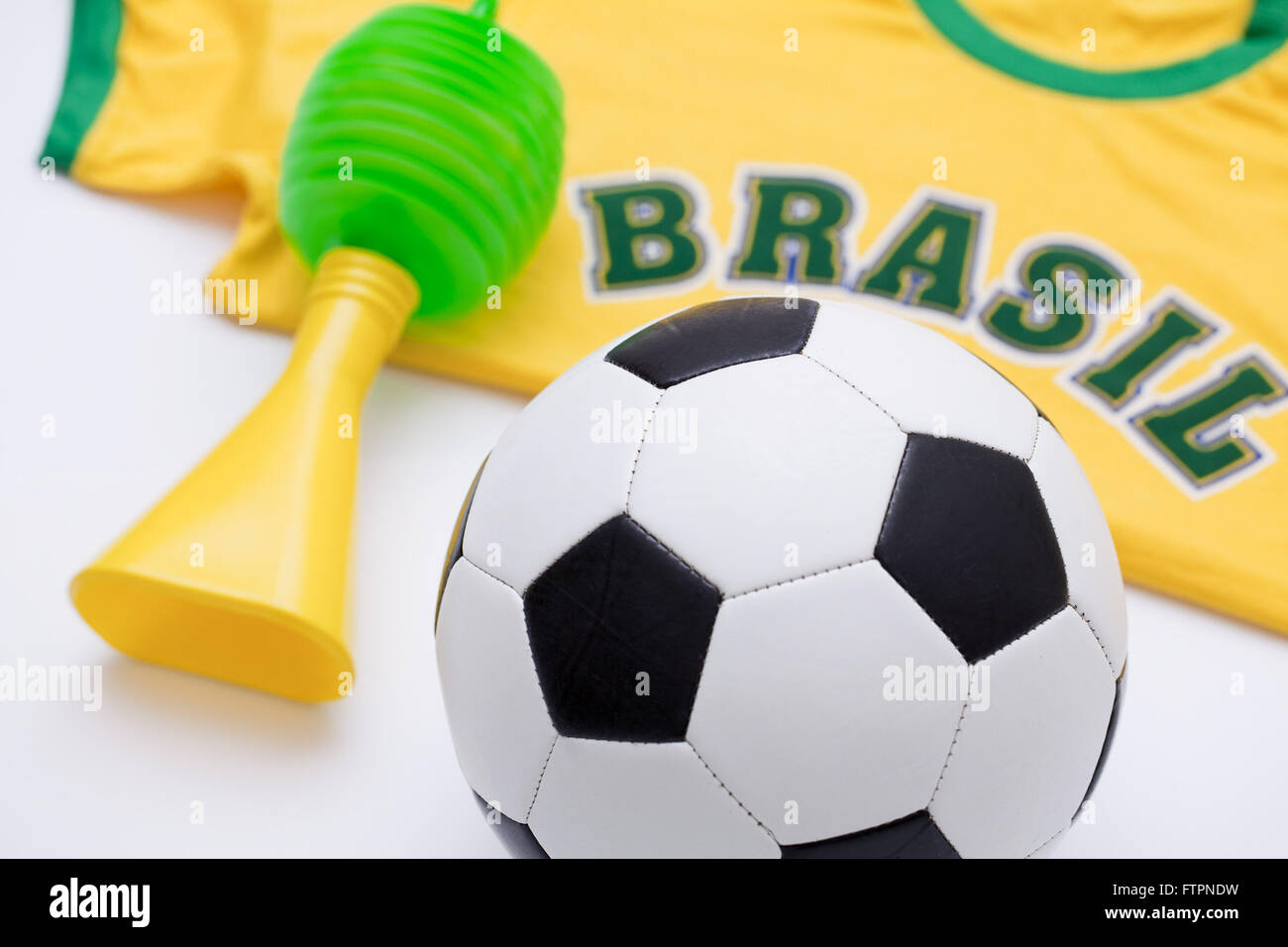 Football shirt and horn - twisted props of the Brazilian selection - Stock Image