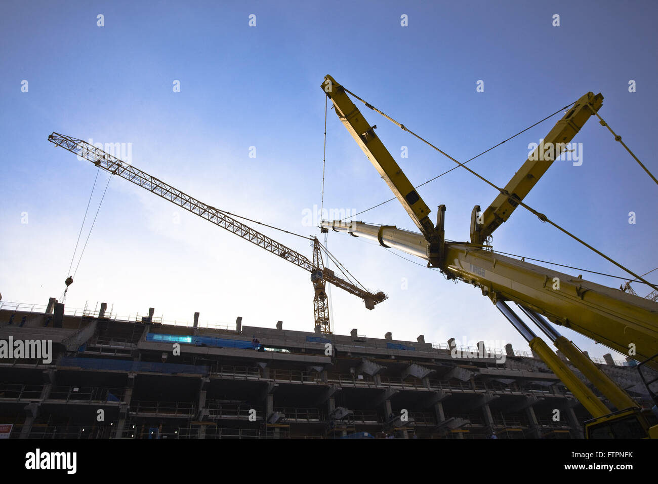 Launcher crane and concrete in construction work of the Corinthians stadium Arena Stock Photo