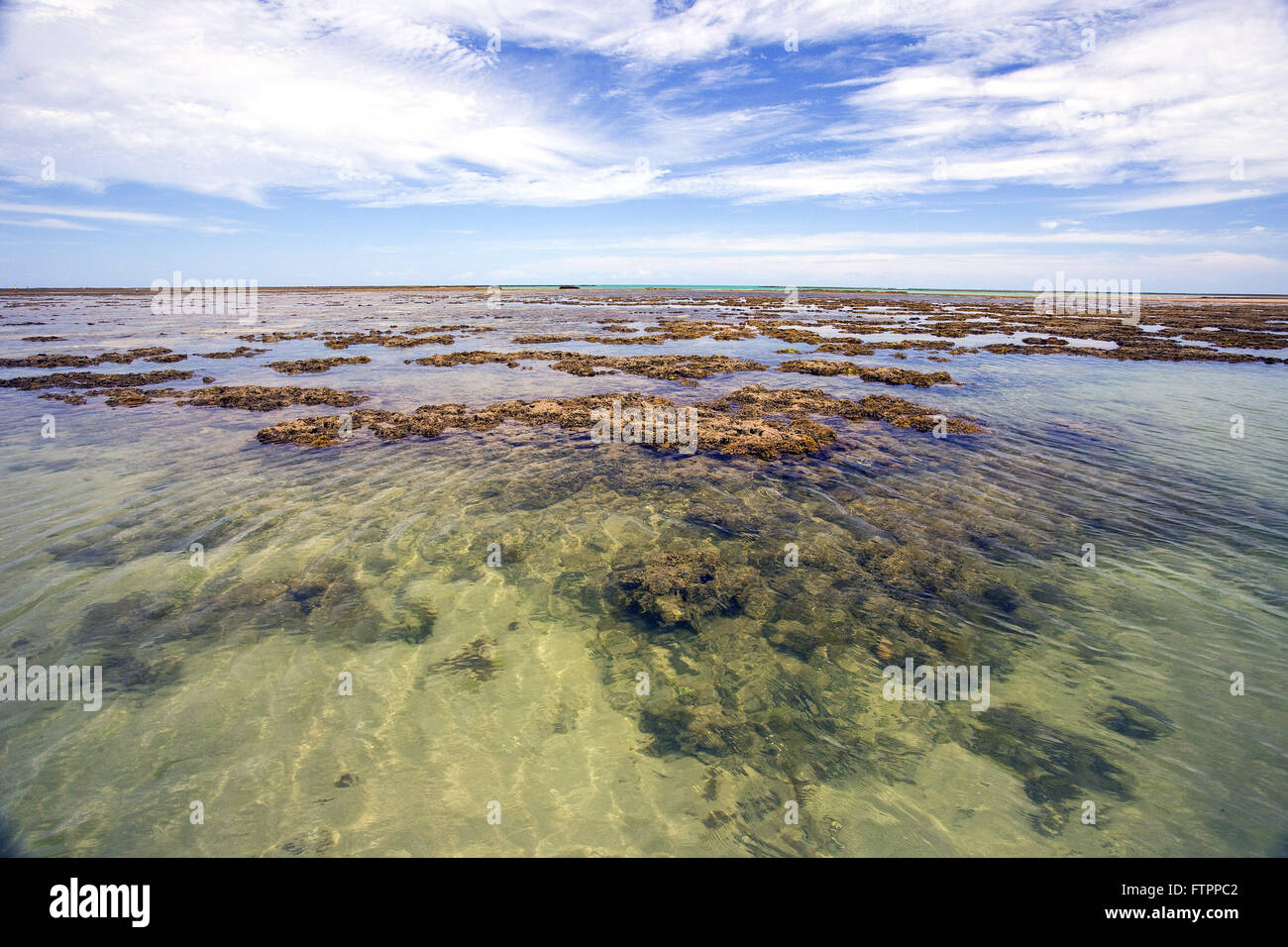 Natural pools formed on the reefs during low tide - Stock Image