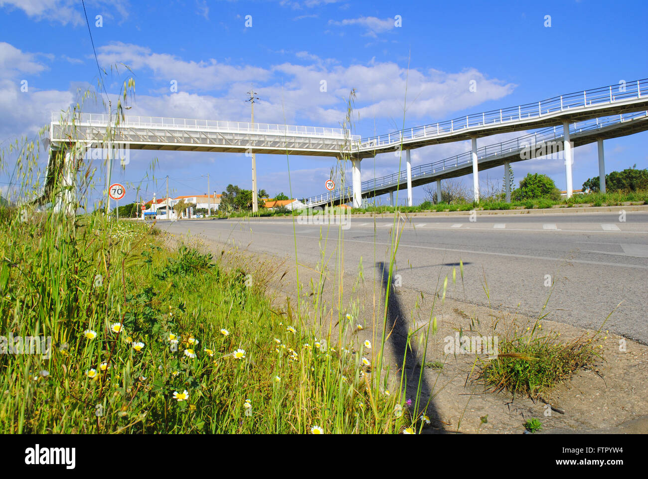 A footbridge over the N125 national road for pedestrians and cyclists in the Algarve region, Portugal. Stock Photo