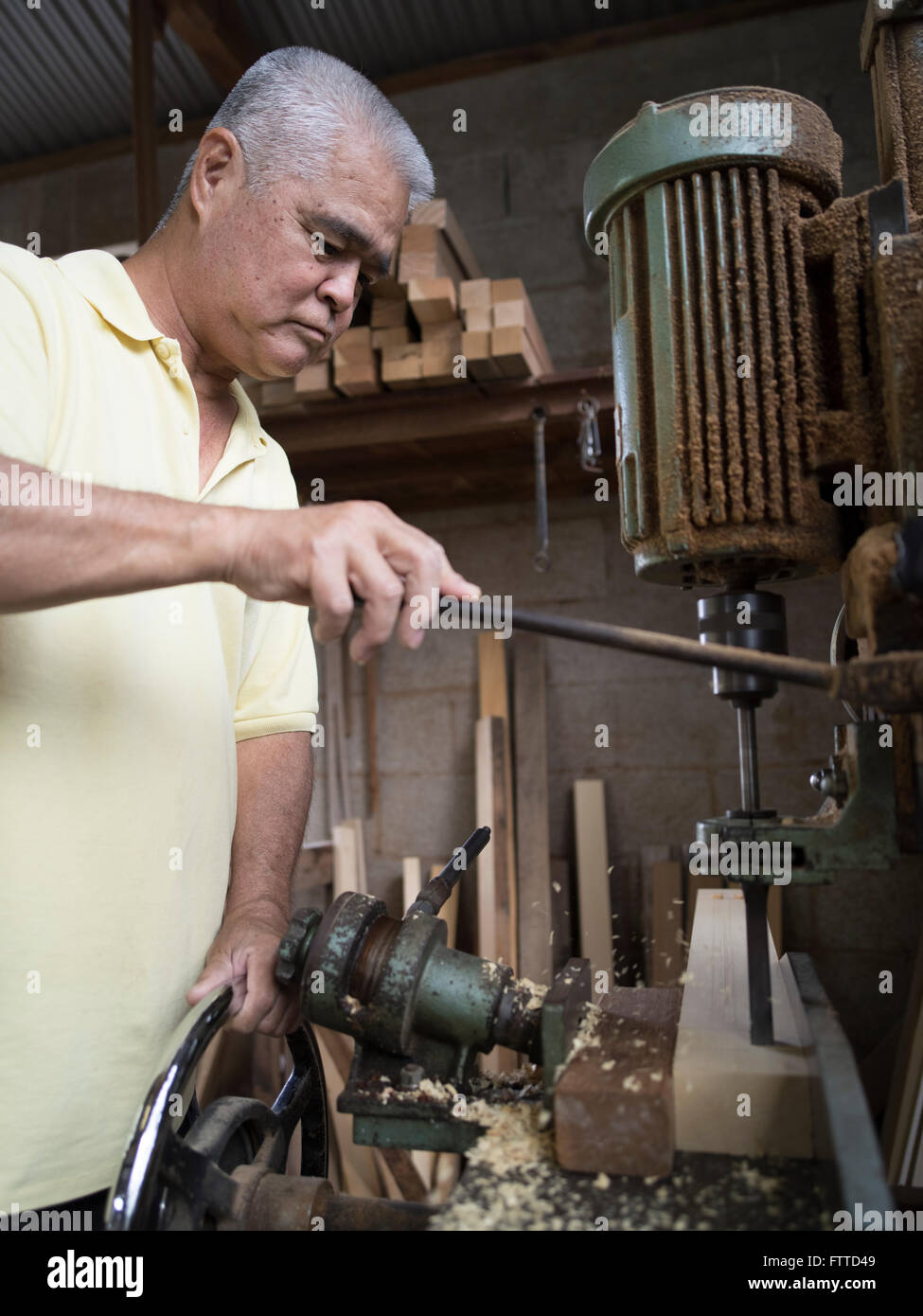 Oshiro Yoshimasa (57) carpenter making  weaving loom , Haebaru, Okinawa 大城織機製作所 Stock Photo