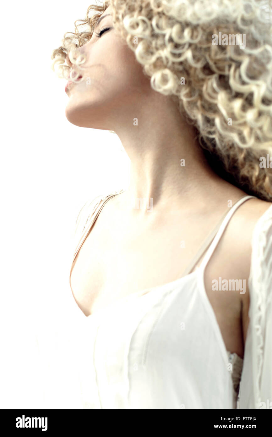 Curly blond woman in the wind - Stock Image