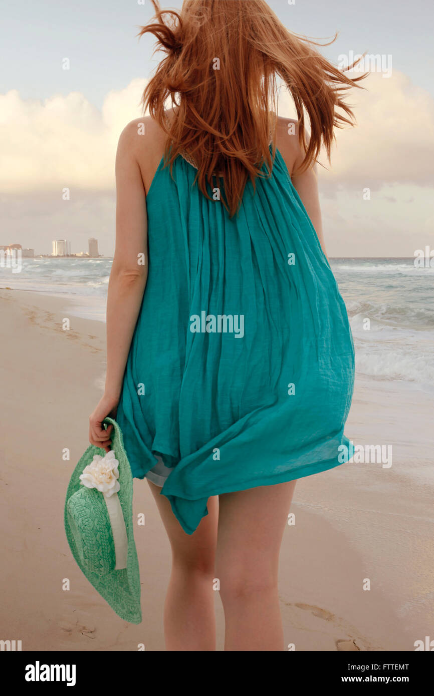Woman walking on beach Stock Photo