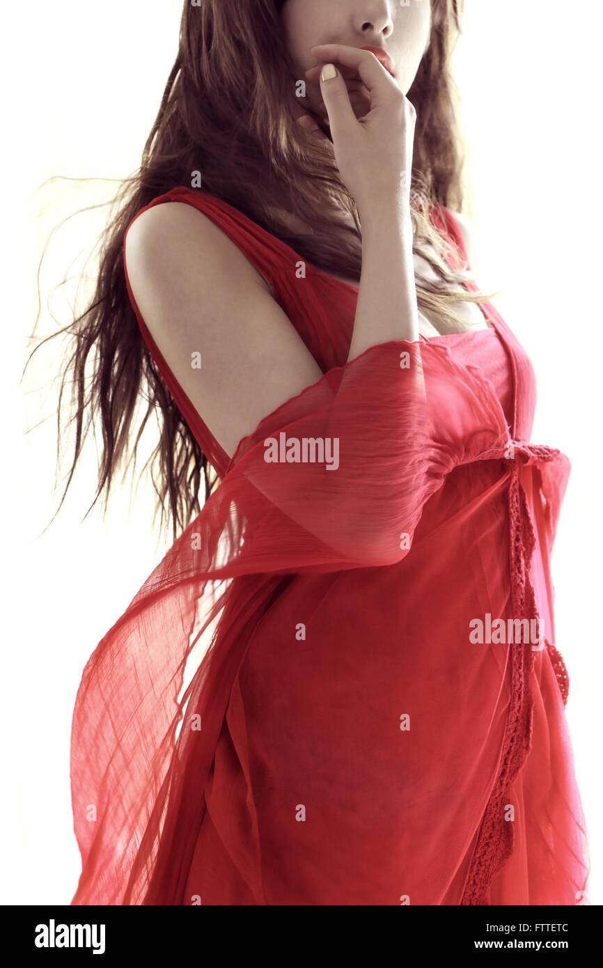 Brunette in red dress - Stock Image