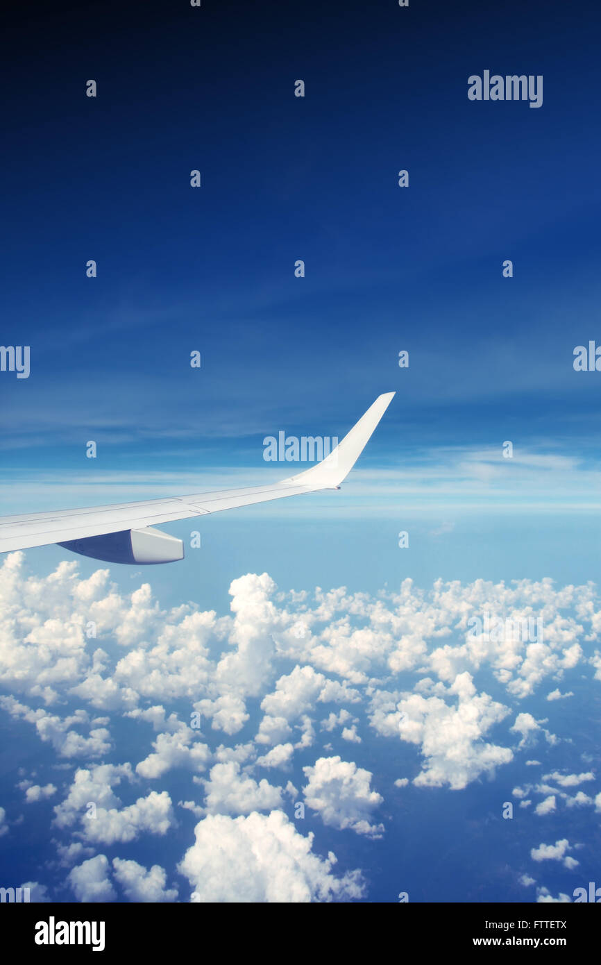 Airplane wing in the sky - Stock Image