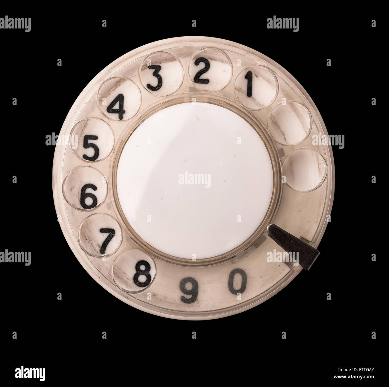 Close up of old rotary phone dial isolated on black - Stock Image