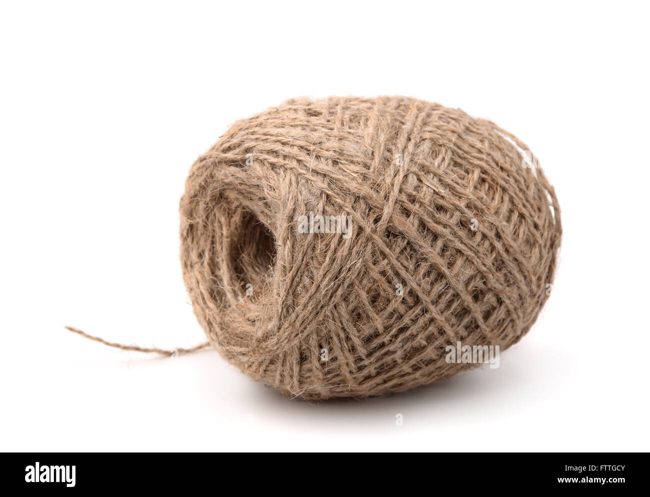 Skein of jute twine isolated on white - Stock Image