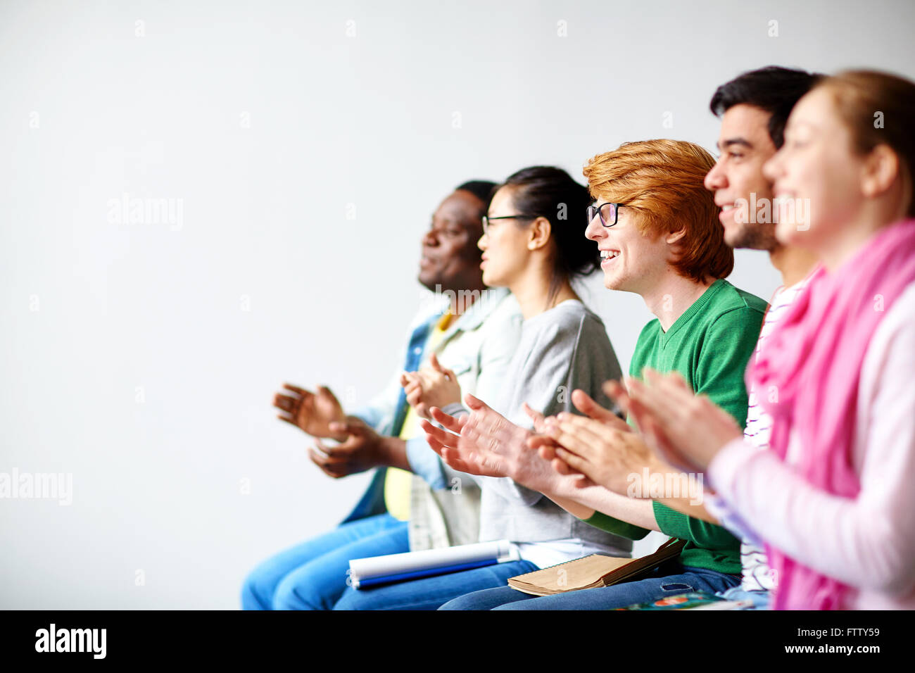 Students clapping hands Stock Photo