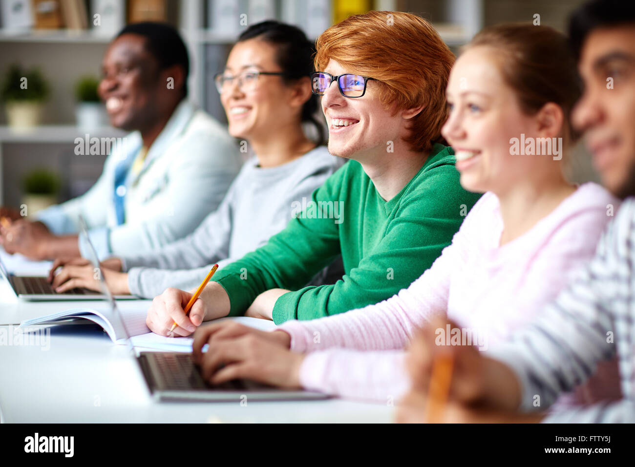 Sitting at lesson - Stock Image