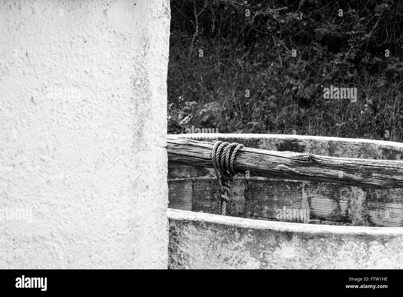 A black and white shot of a well in Portugal - Stock Image