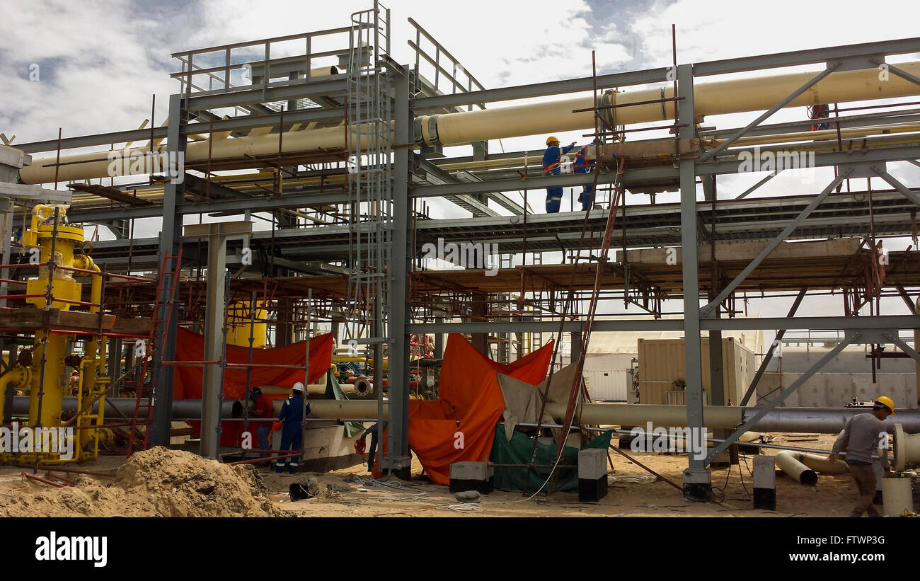 Men working on construction of oil and gas processing plant in Egypt