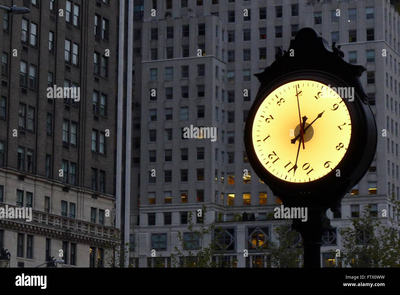 Rotating Face Clock in New York City - Stock Image