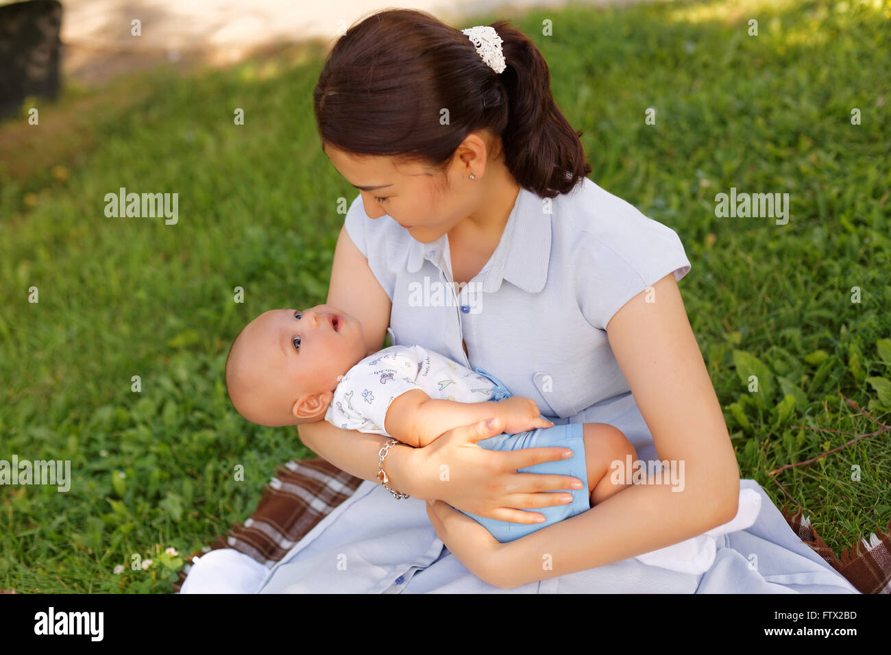 431759da41c0 cute baby boy with mother in the park Stock Photo  101376225 - Alamy