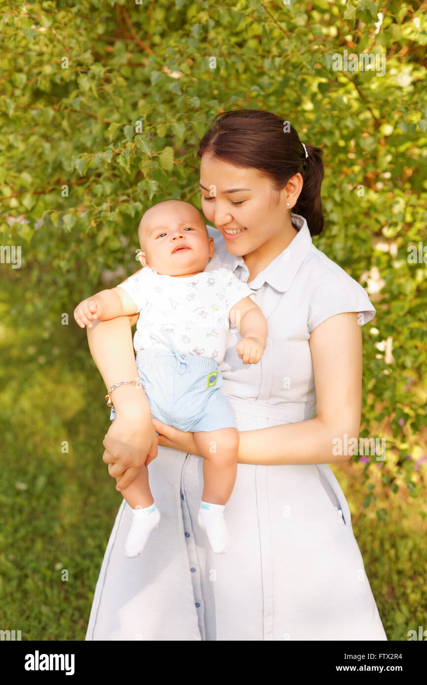 2b187888d704 cute baby boy with mother in the park Stock Photo  101376552 - Alamy