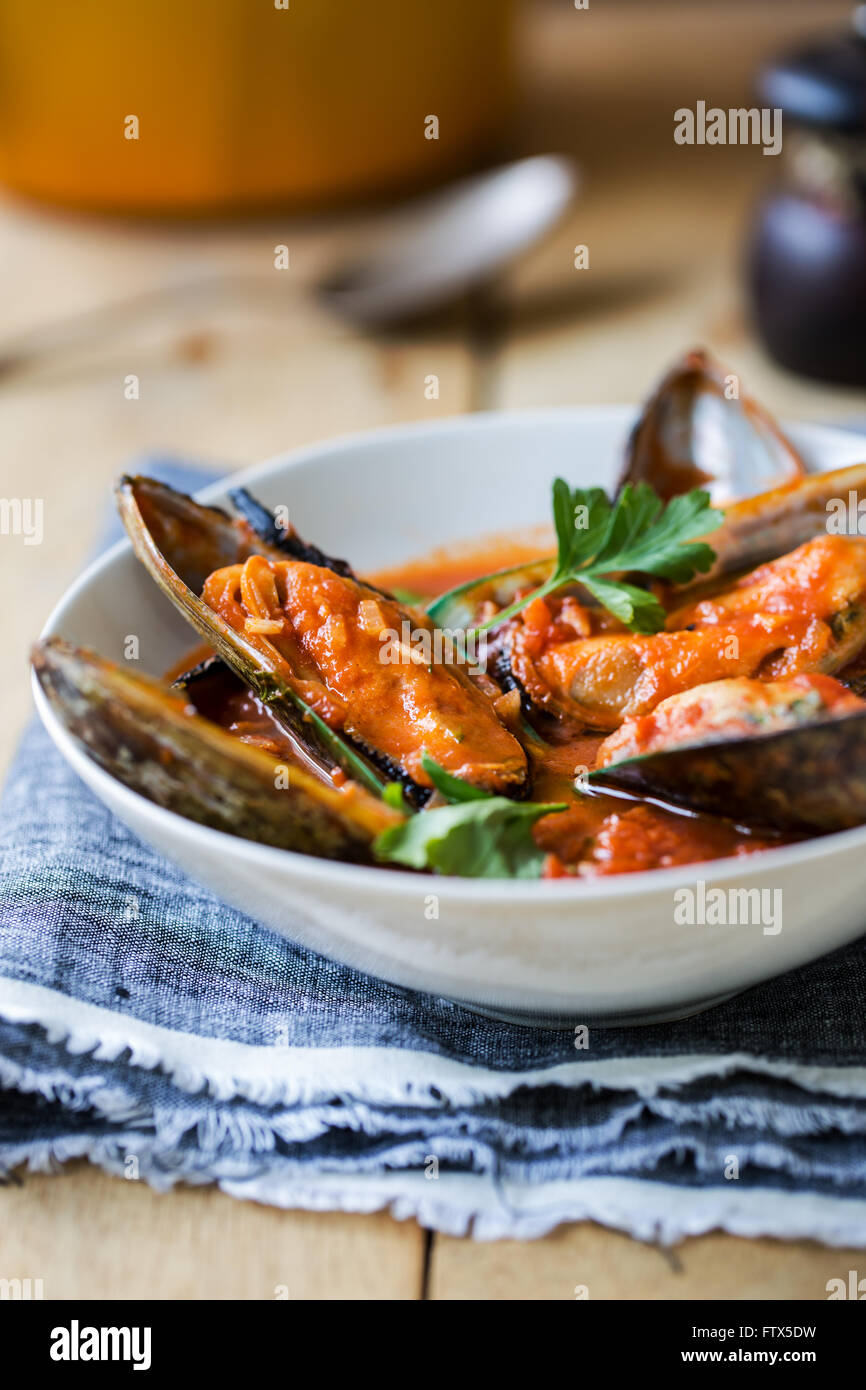 New zealand Mussels in Tomato and herbs sauce Stock Photo