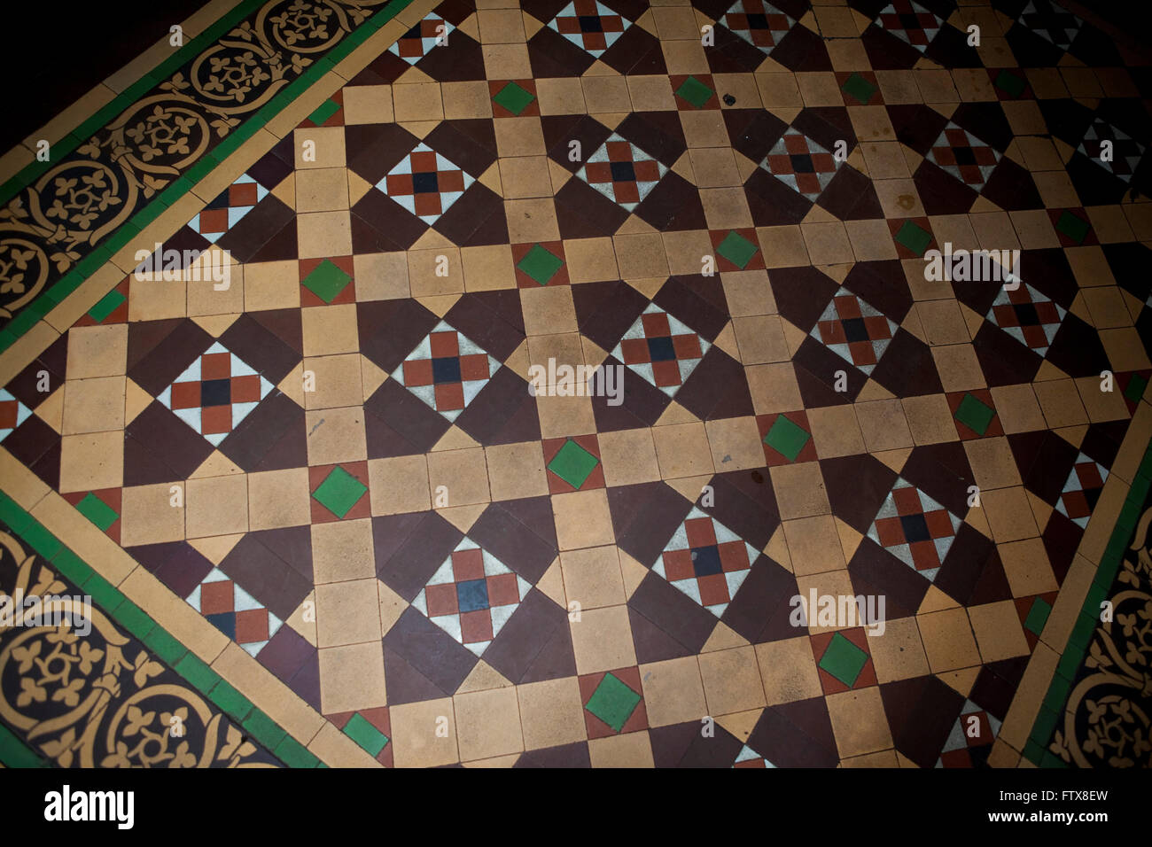 An old mosaic patterned hallway floor mad eup of many small tiles an old mosaic patterned hallway floor mad eup of many small tiles to create an intricate pattern probably victorian or edwardian dailygadgetfo Choice Image