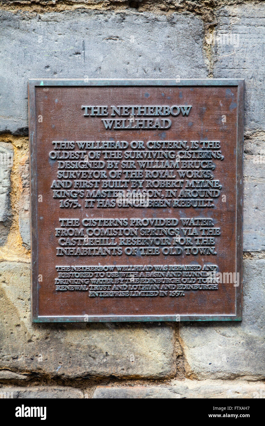 A plaque detailing the history of the Netherbow Wellhead on the Royal Mile in Edinburgh, Scotland. Stock Photo