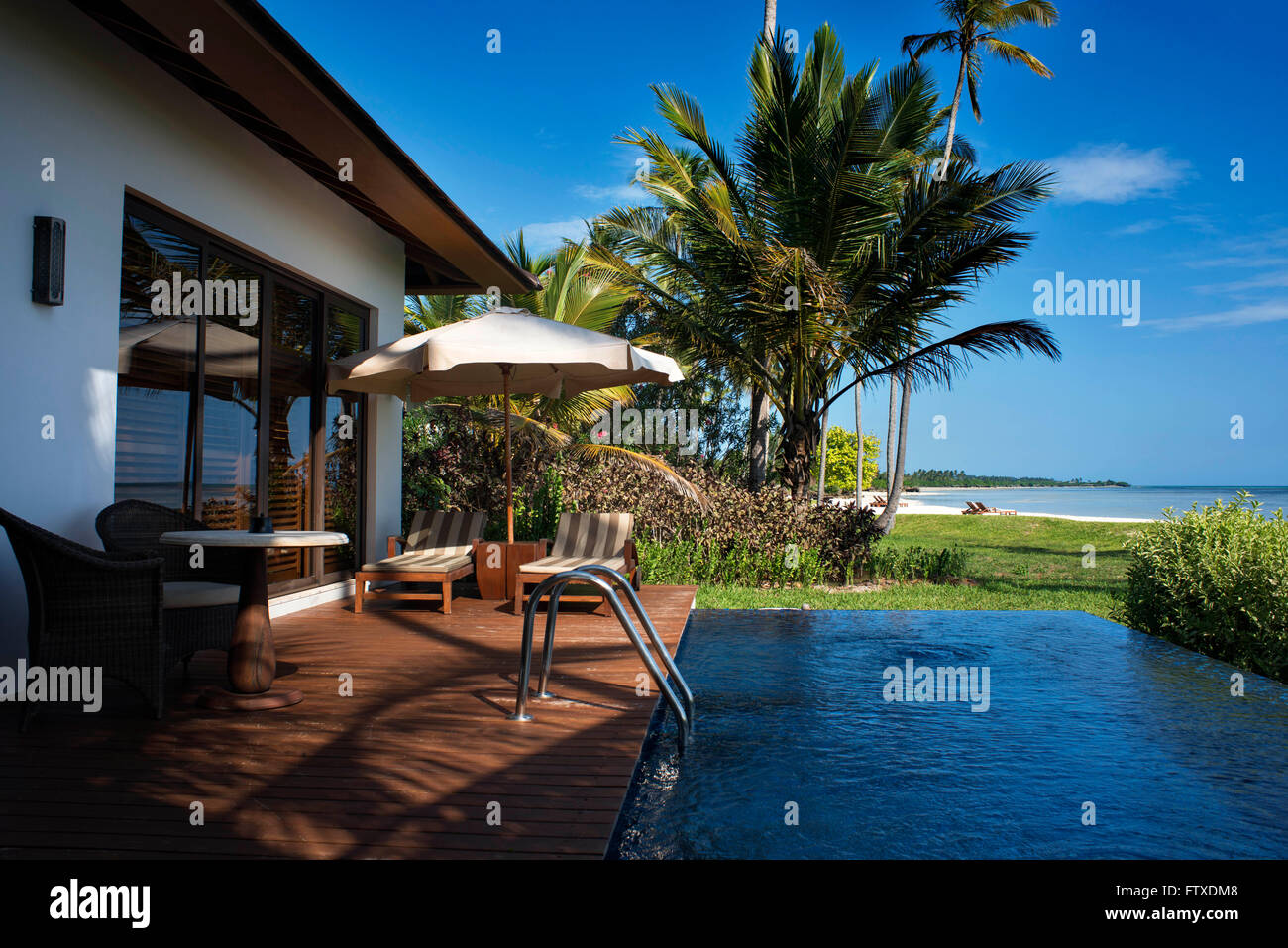 Swimming pool and outside luxury villa in The Residence Hotel in Zanzibar island a semi-autonomous part of Tanzania, - Stock Image