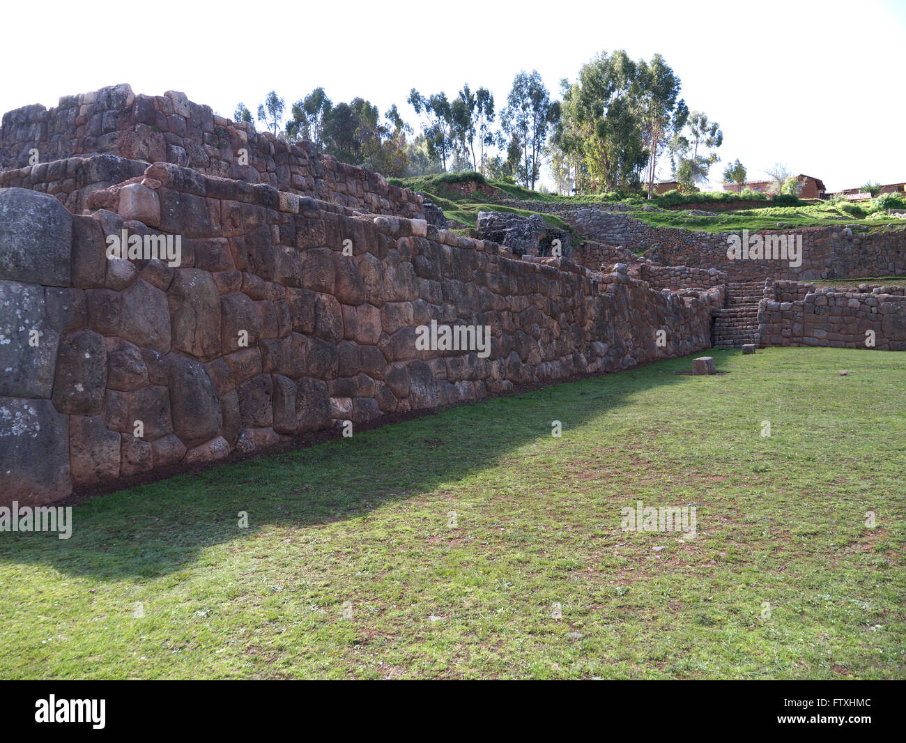 Chinchero ruins and terraces in the Sacred Valley of the Incas.  Massive stone wall in main plaza with ten trapezoidal - Stock Image