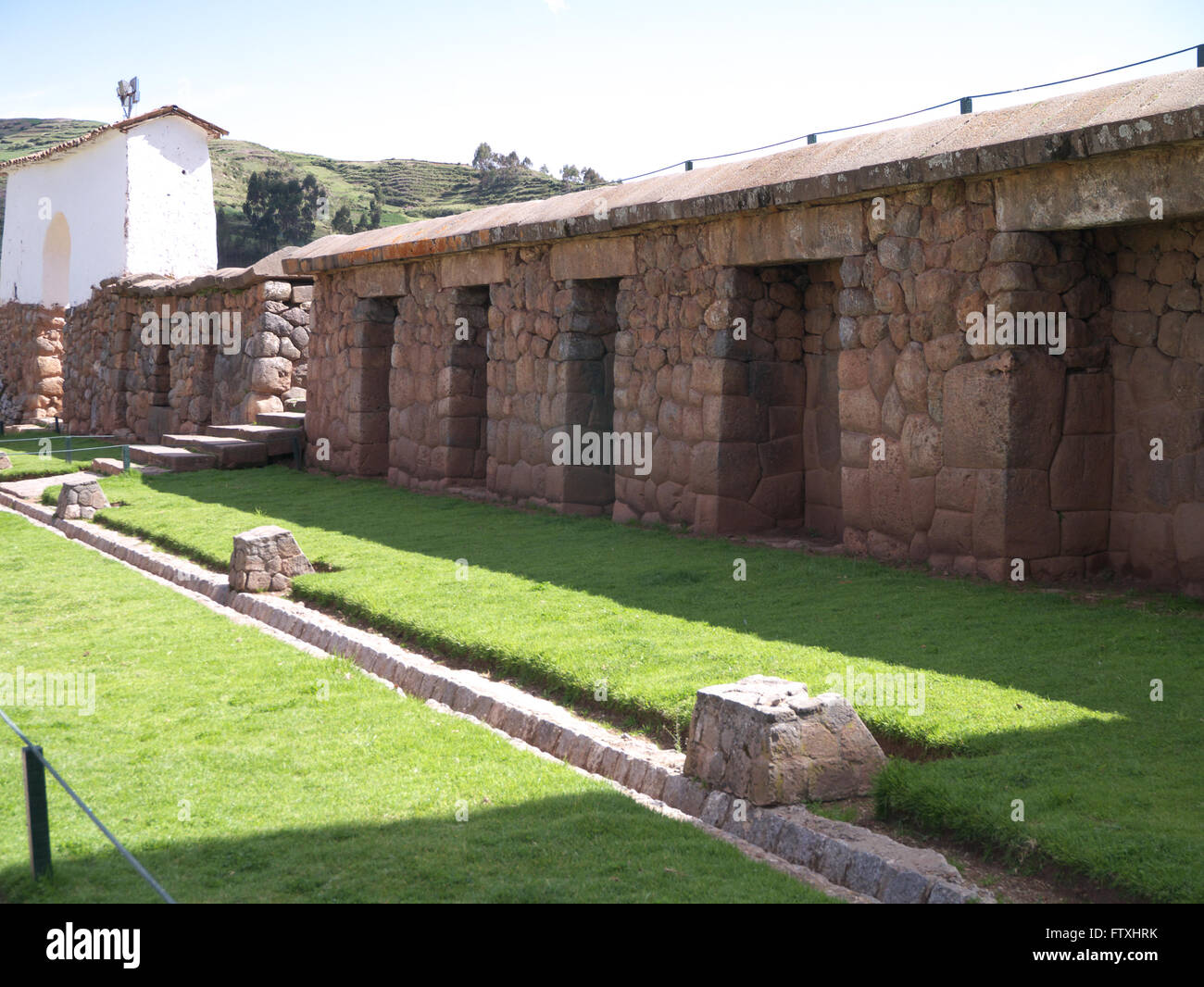 Chinchero ruins in the Sacred Valley of the Incas.  Massive stone wall in main plaza with ten trapezoidal niches - Stock Image