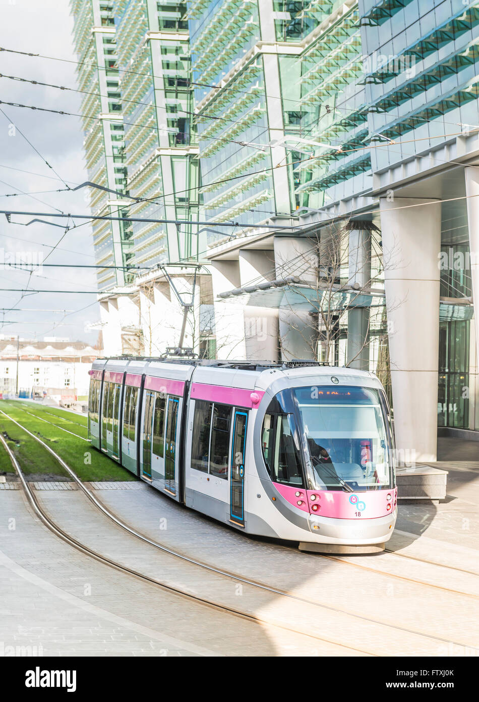 Electric tram in Snow Hill, Birmingham City Centre. England. - Stock Image