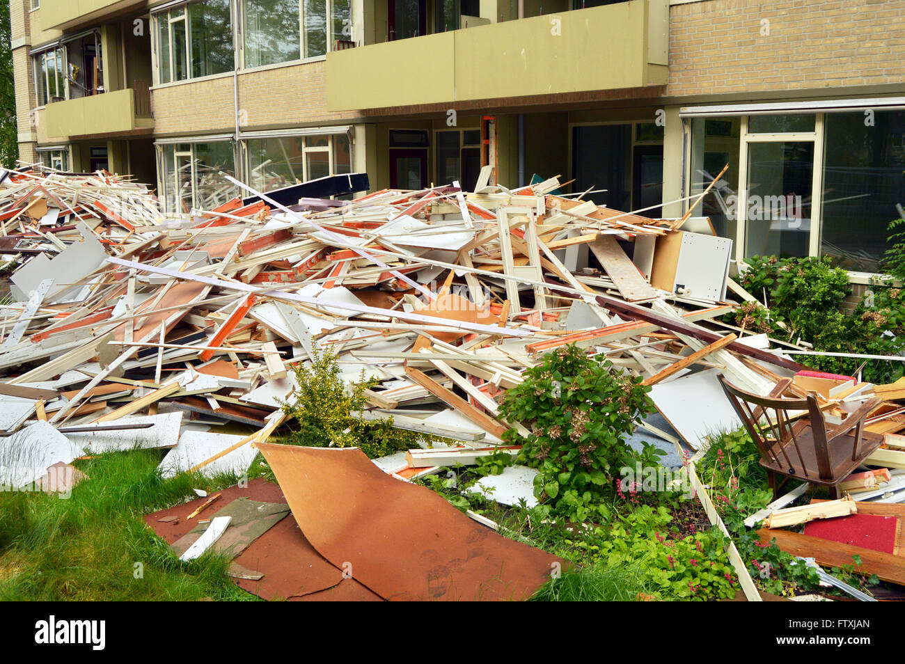 Demolition. Door and window frames stack of a deconstructed building - Stock Image