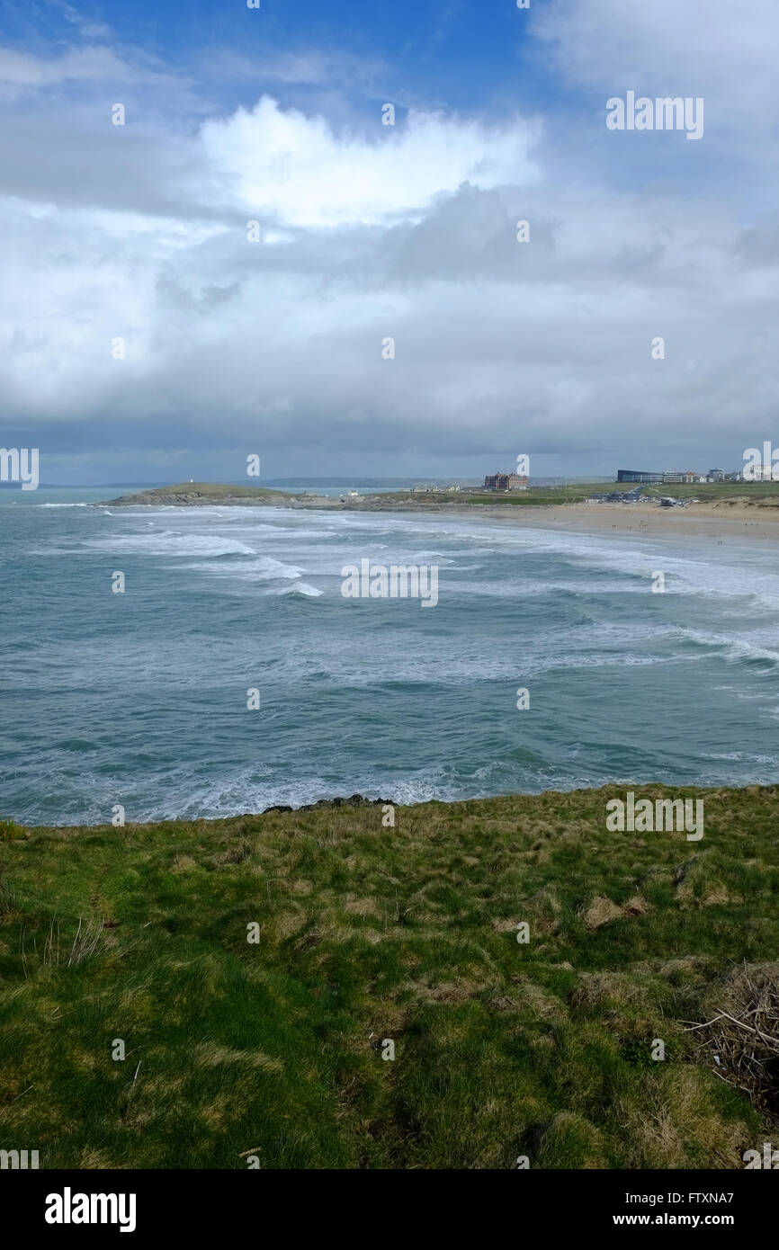 Upright view looking east across Fistral Bay, Newquay, Cornwall with blue sky and fluffy clouds - Stock Image