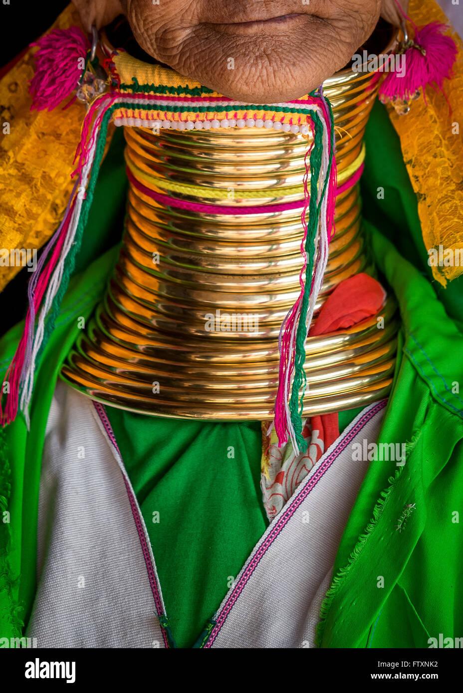 Padaung Tribe's Woman wearing golden rings around neck Stock Photo