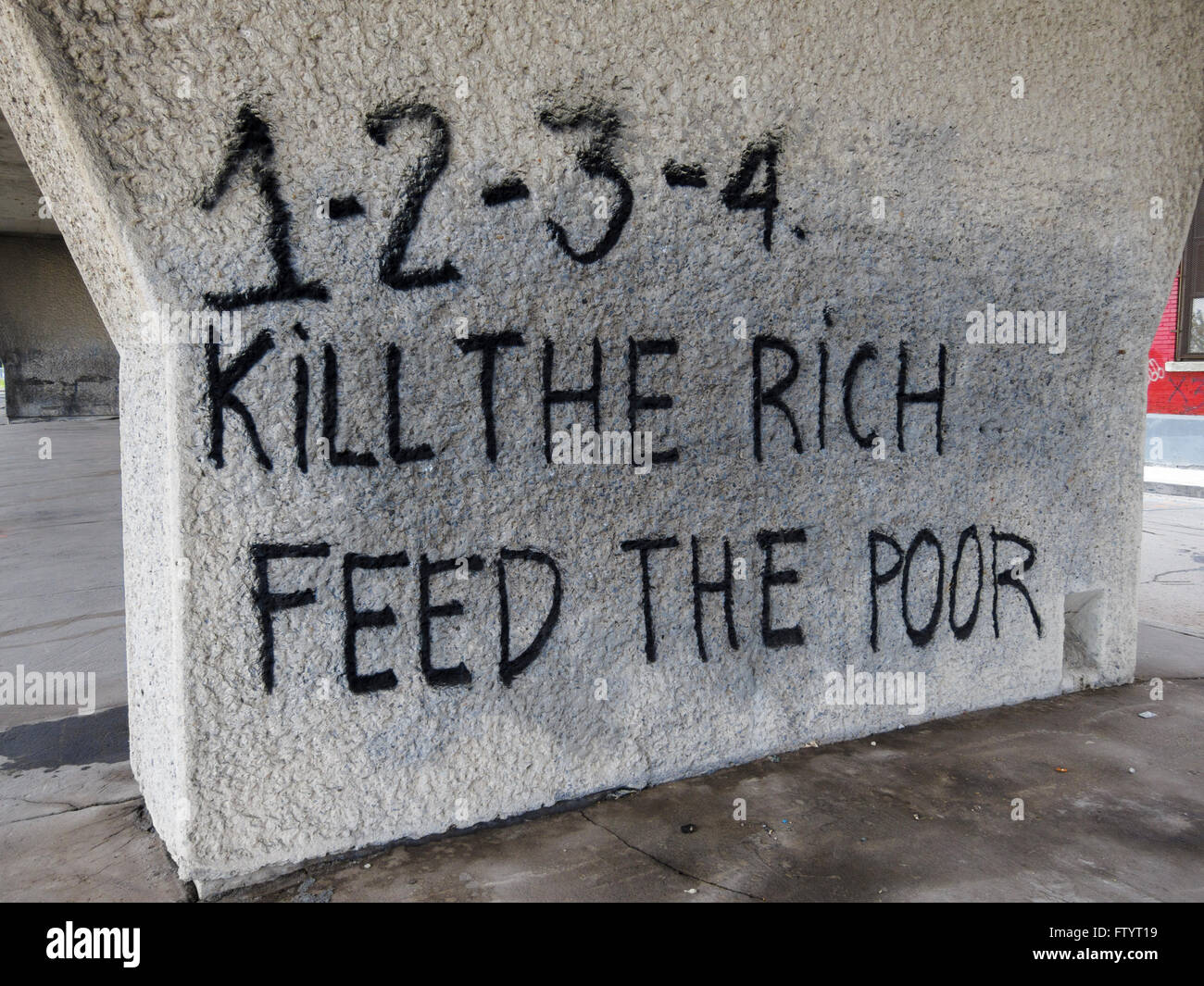 1-2-3-4, Kill the Rich, Feed the Poor. Graffiti protesting income inequality. Montreal, Quebec, Canada. - Stock Image