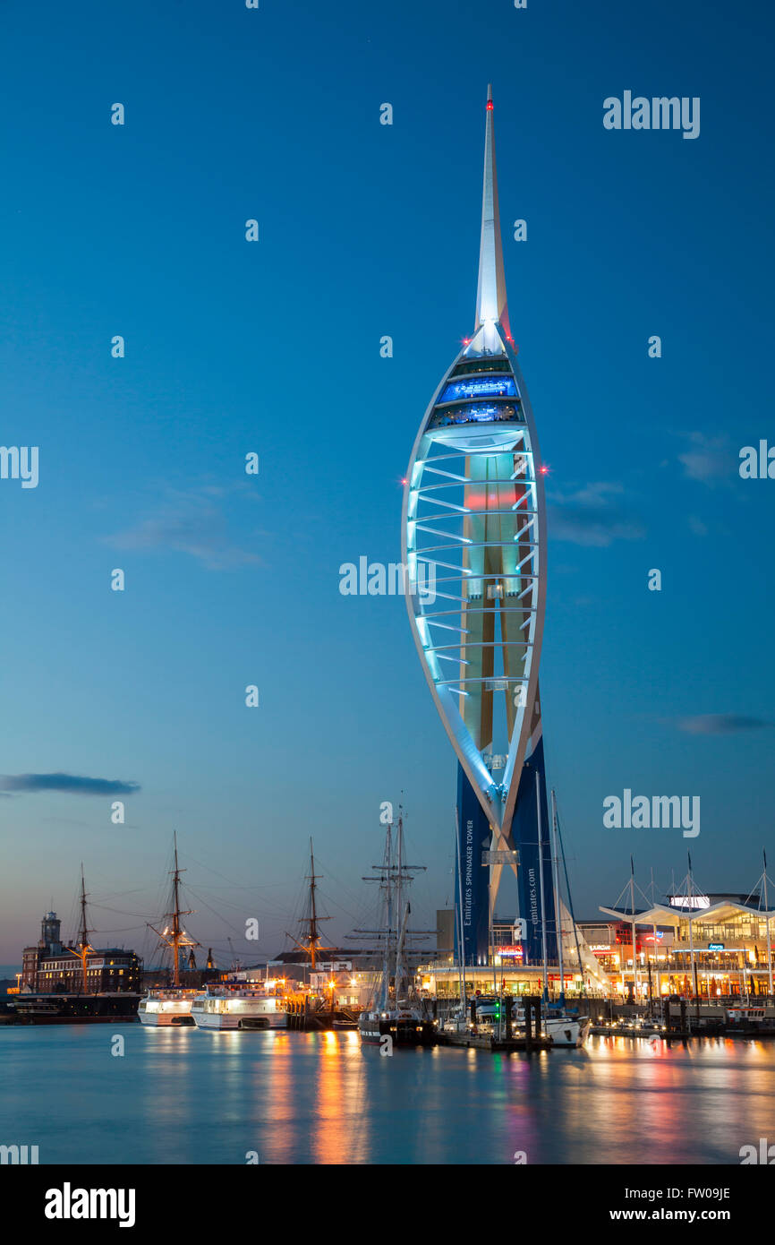Night falls at the Spinnaker Tower in Portsmouth Harbour, Hampshire, England. Stock Photo