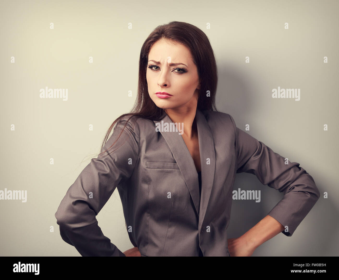 Stressed angry business woman in suit looking. Toned emotional portrait - Stock Image