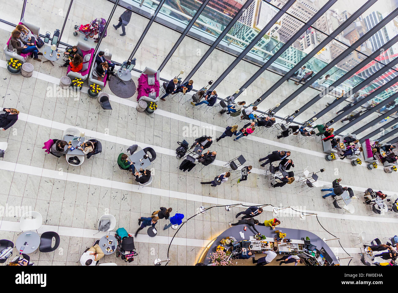 London, United Kingdom - March 23, 2016: Visitors are relaxing in the bar restaurant area of the Sky Garden. - Stock Image