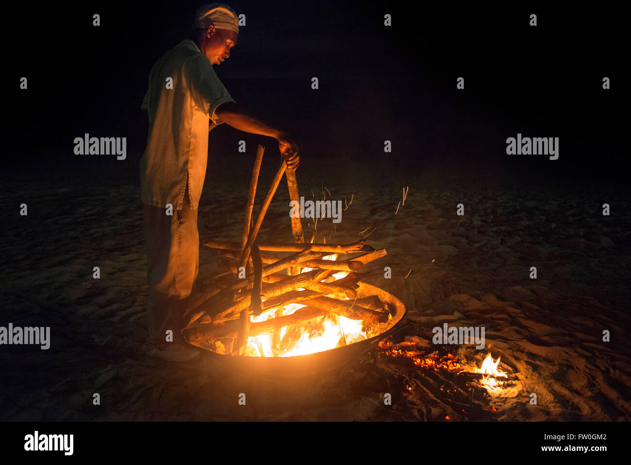 Fire for a barbecue in the beach of The Residence Hotel in Zanzibar island a semi-autonomous part of Tanzania, in - Stock Image
