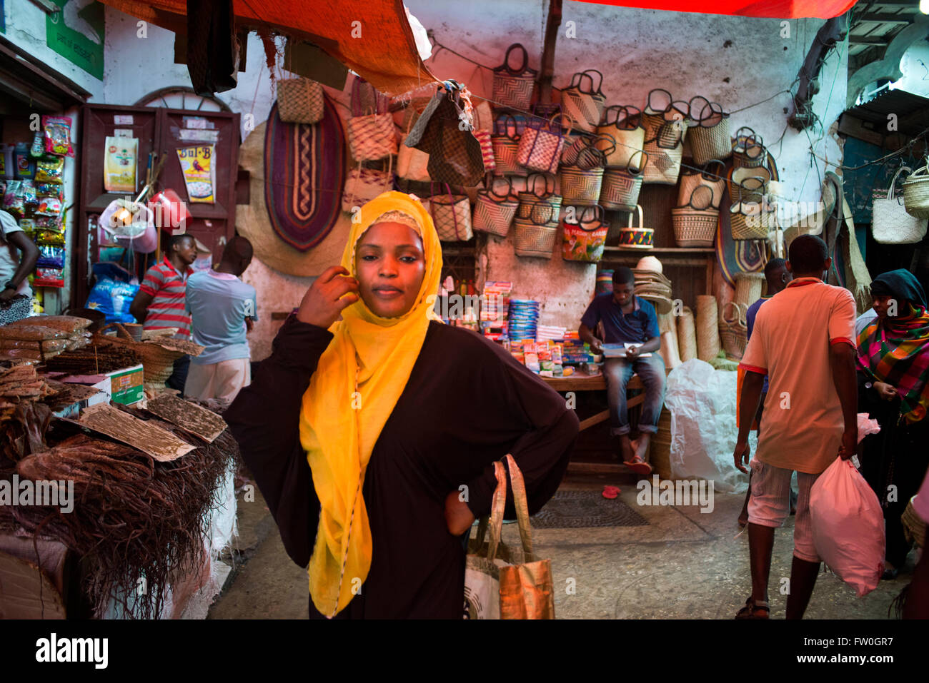 Portrait of a woman in the market in Sone Town, Zanzibar.  Sale of dry fish, wicker baskets and ohter different Stock Photo