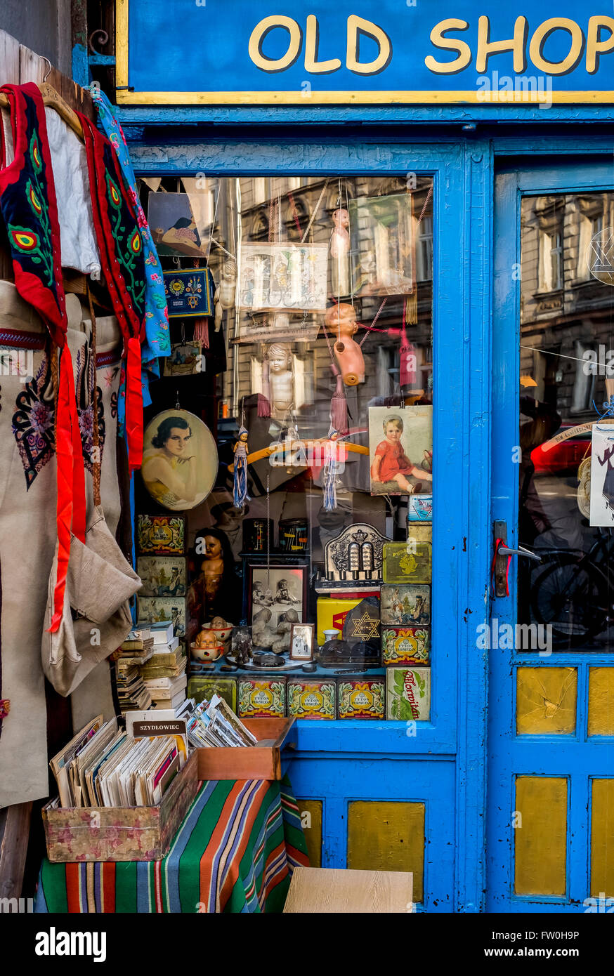 Curiosity Shop front window full of antiques and memorabilia in Jewish Quarter, Krakow, Lesser Poland - Stock Image